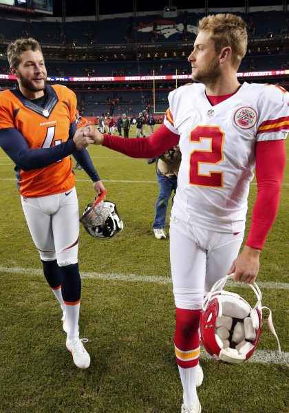 FILE - In this Nov. 15, 2015, file photo, Denver Broncos punter Britton Colquitt, left, shakes hands with his brother Kansas City Chiefs punter Dustin Colquitt following an NFL football game in Denver. Like his father, Britton has a chance to win his own ring Sunday when his Broncos face the Carolina Panthers in Super Bowl 50. Their dad Craig Colquitt won two Super Bowls with the Pittsburgh Steelers. (AP Photo/Jack Dempsey, File) ORG XMIT: NY164